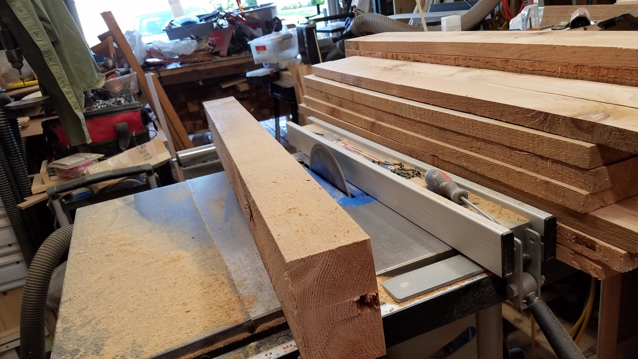 Ripping 6x6 cedar posts to 1x6 boards. After this, off to the thickness planer.