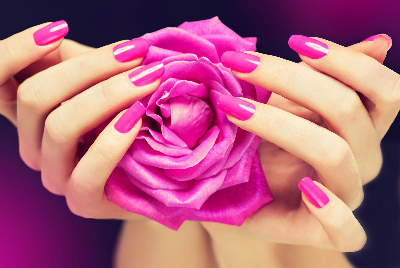 bigstock-Manicured-hands-with-bright-pi-121323041.jpg