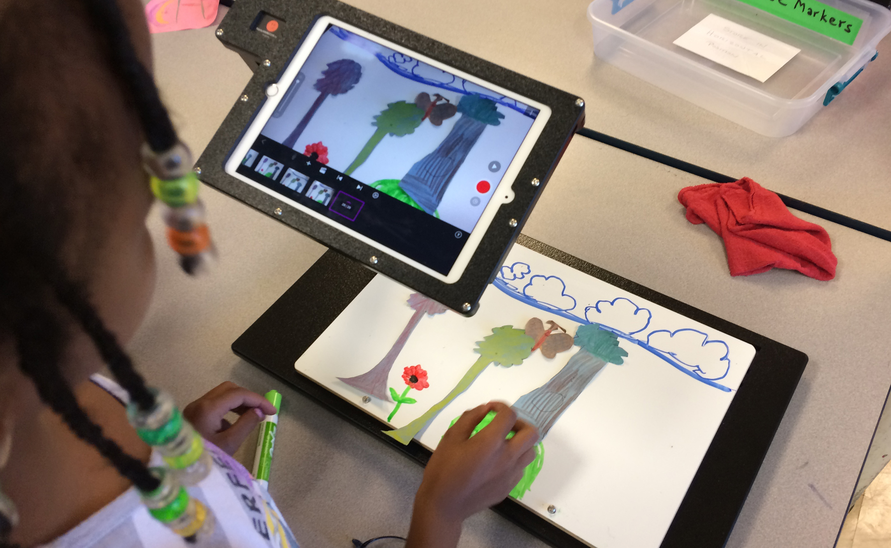 An elementary school's art classroom became an animation studio for a semester, as students used ReadyANIMATORs to express what they learned in science class by creating paper cutout animation about water cycles and plant cycles. The series was made possible by an arts council grant.
