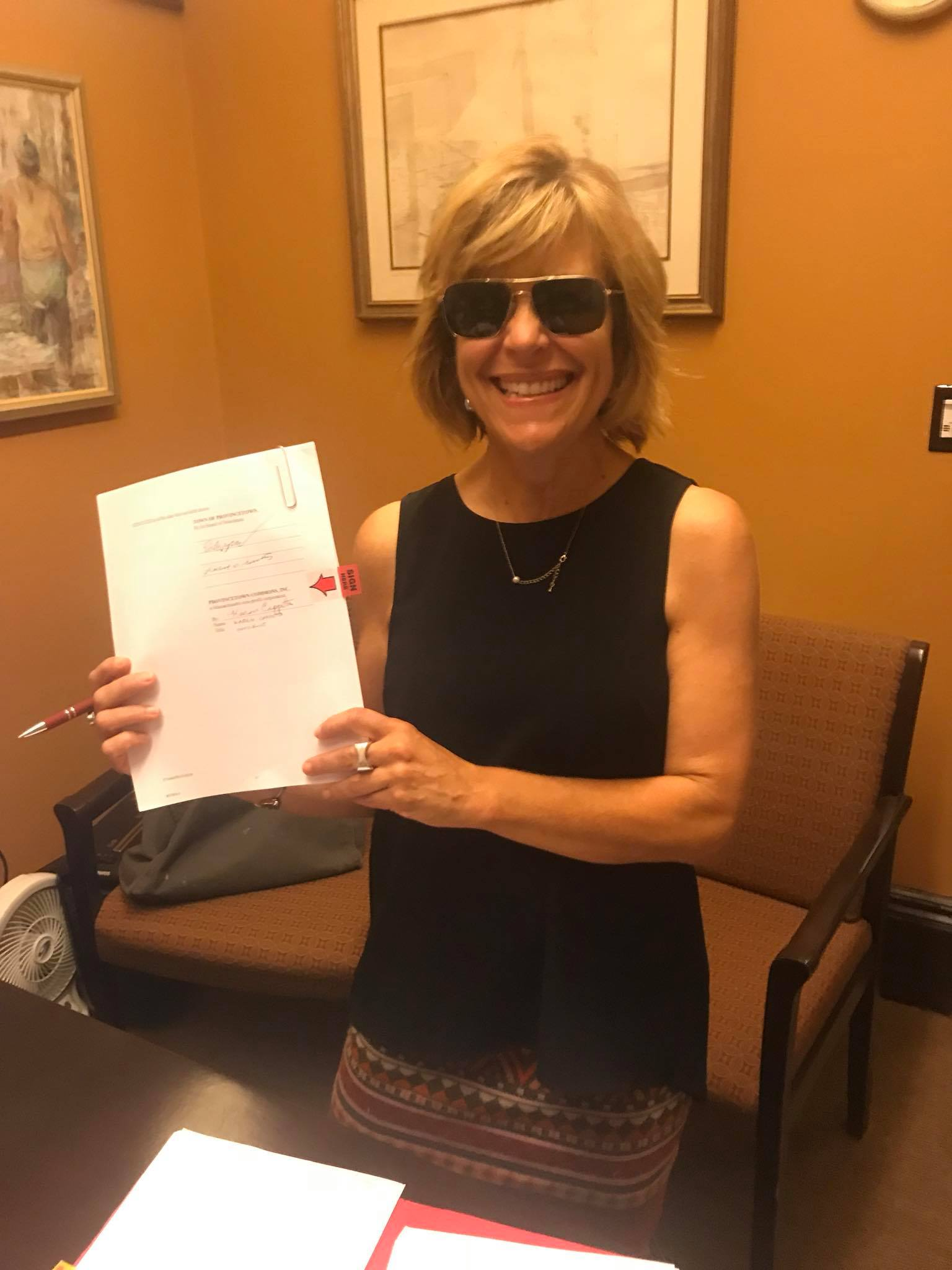 Provincetown Commons board president Karen Cappotto at Town Hall with the signed 99-year lease for the old Community Center building at 46 Bradford Street.