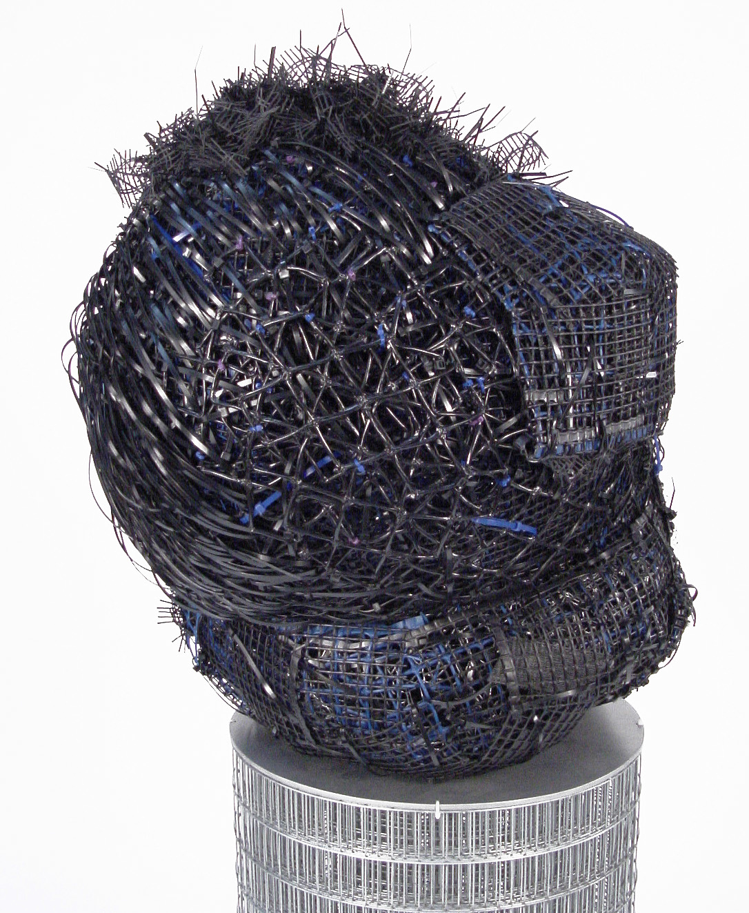 """Big Head   plastic and metal fencing  27 X 18 X 16""""  2004  private collection"""
