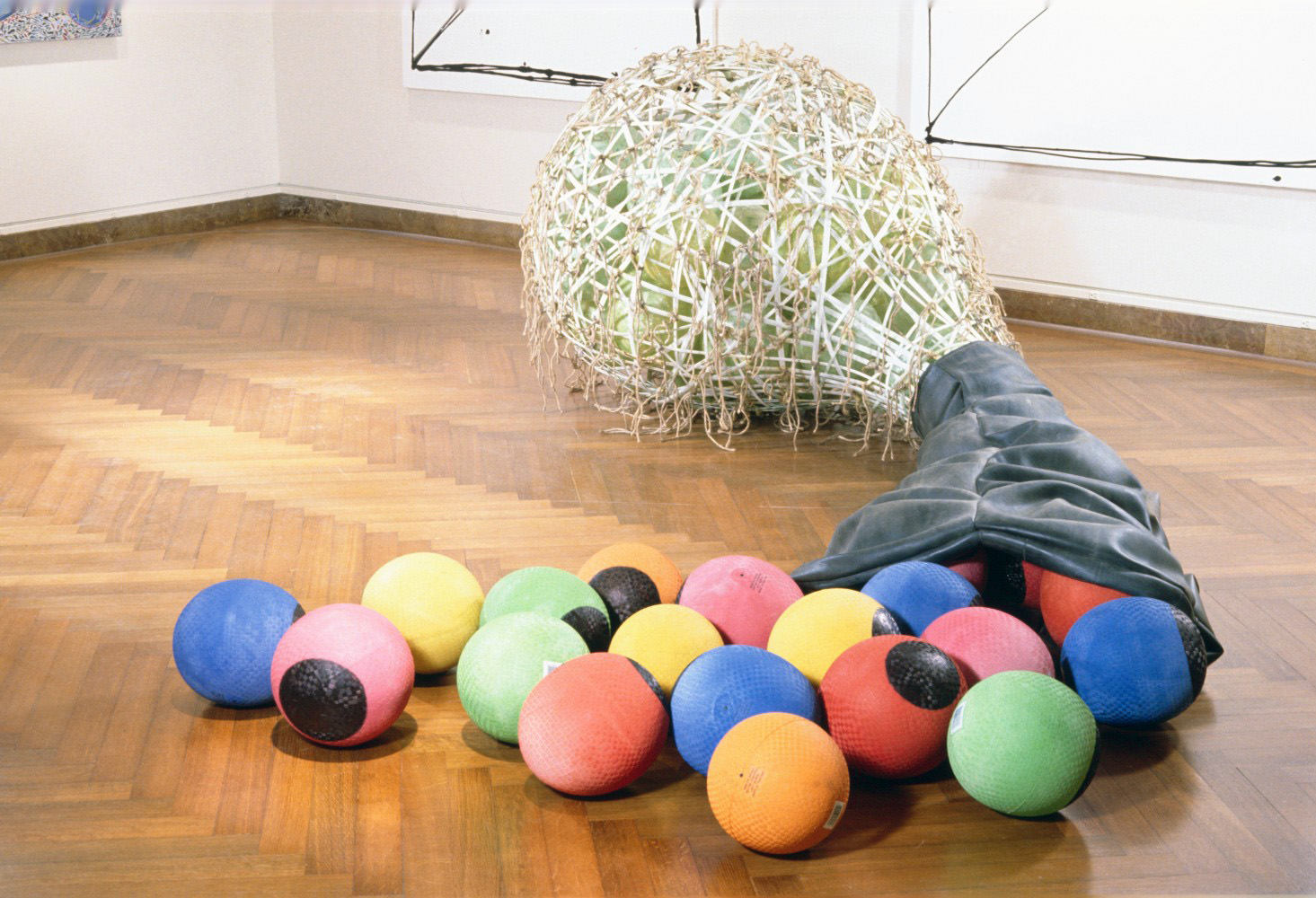 "Kick Balls   1995  fiberglass and rubber  55 X 144 X 72""  NA"
