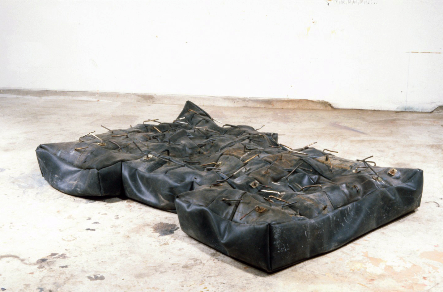 Blow-Up Mattress   1996  rubber and brass  96 X 48 X 9""