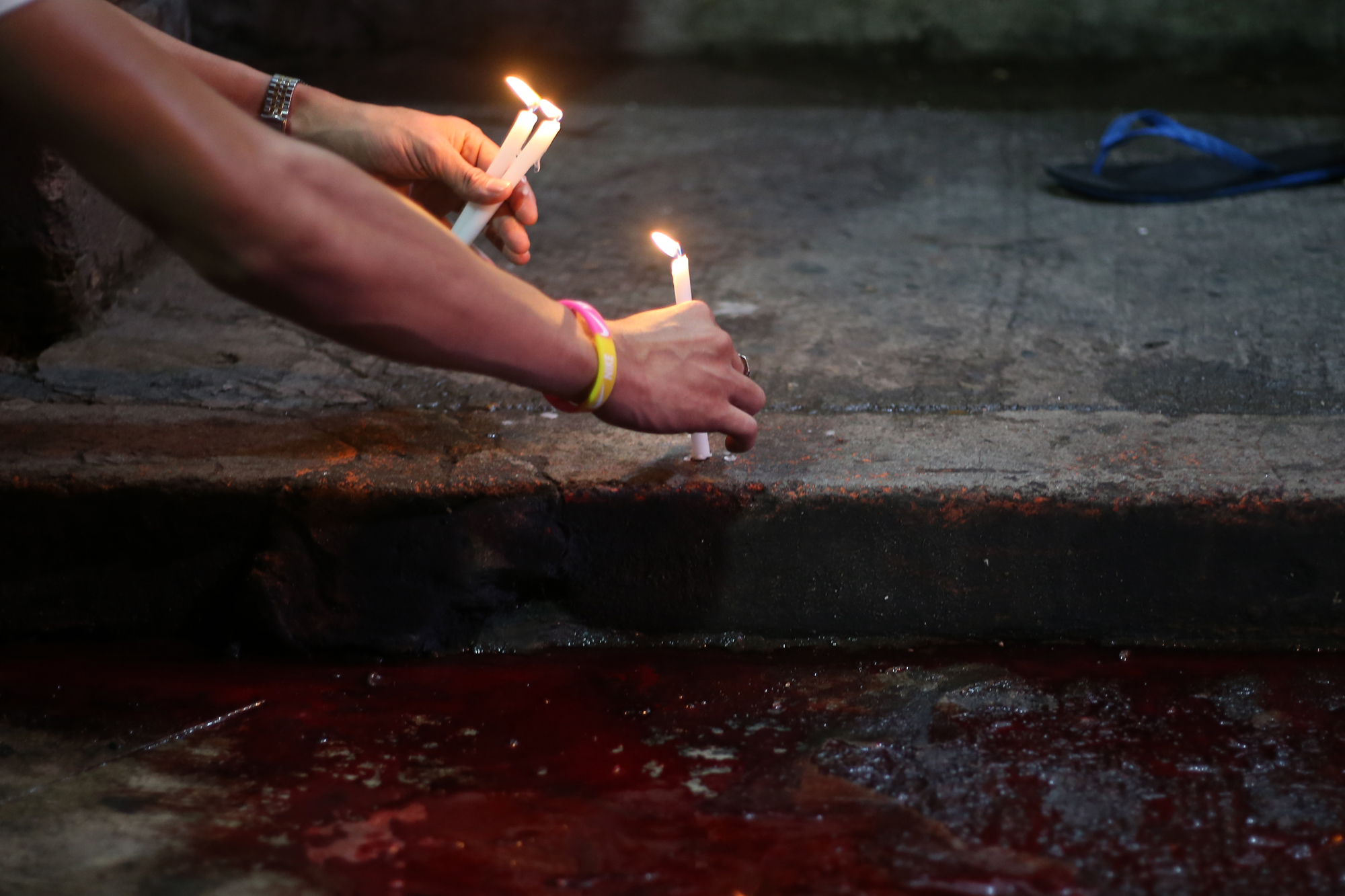 Candles are placed at the crime scene where Alvin Jhon Mendoza was shot and killed by riding-in-tandem suspects at Sta, Ana, Manila on October 12, 2016.