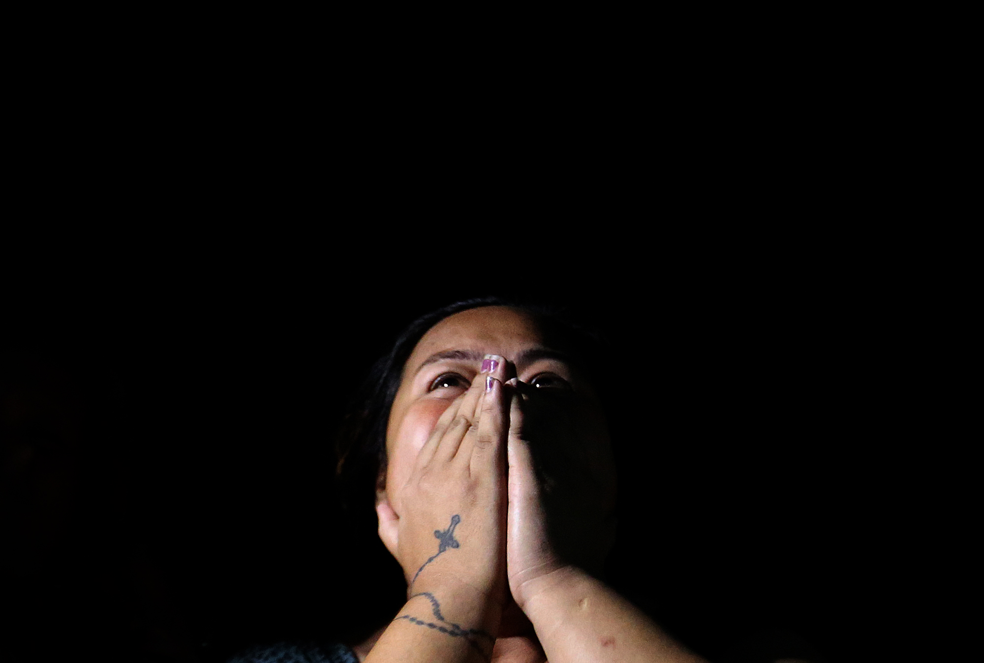 """The sister of Jackie Flores alias """"Chan-Chan""""grieves after seeing the dead body of her brother who was shot to death by still-unidentified suspects along F.B Harrison Street and Libertad, Pasay on October 28, 2016."""
