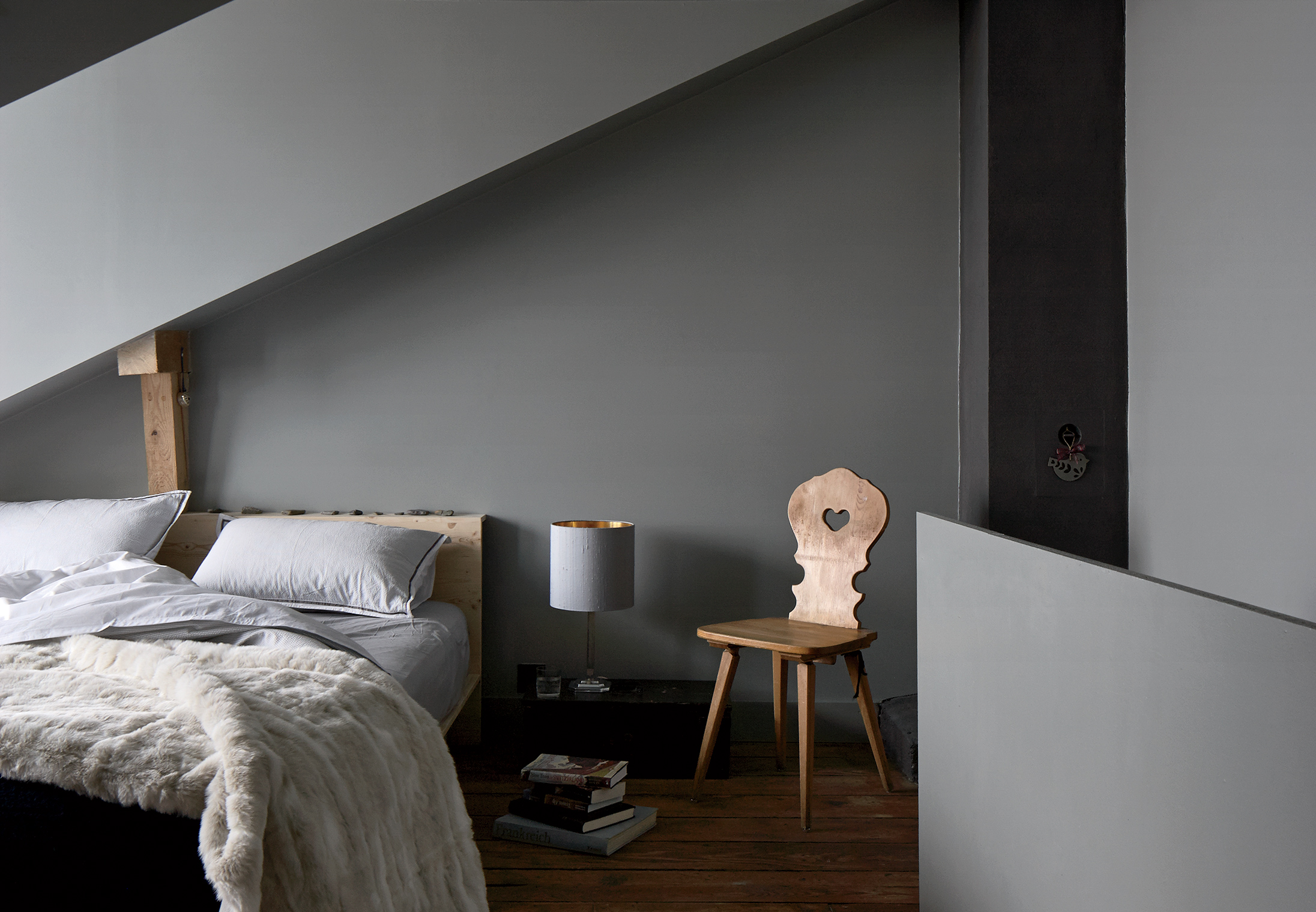 no-half-measures-switzerland-family-getway-renovation-small-space-bedroom-brass-wall-light-john-glew-rectangle.jpg
