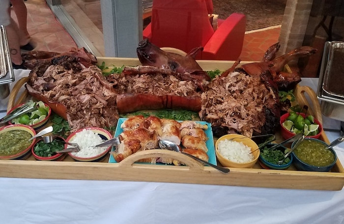 A Cuban pig roast with all the trimmings.