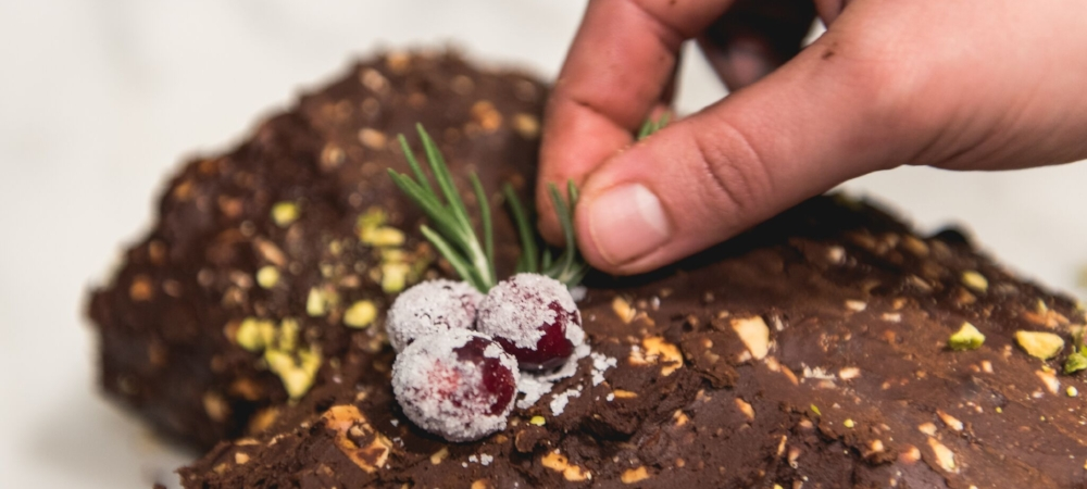 Use cranberries and rosemary sprigs in clusters to create a holly-like effect.