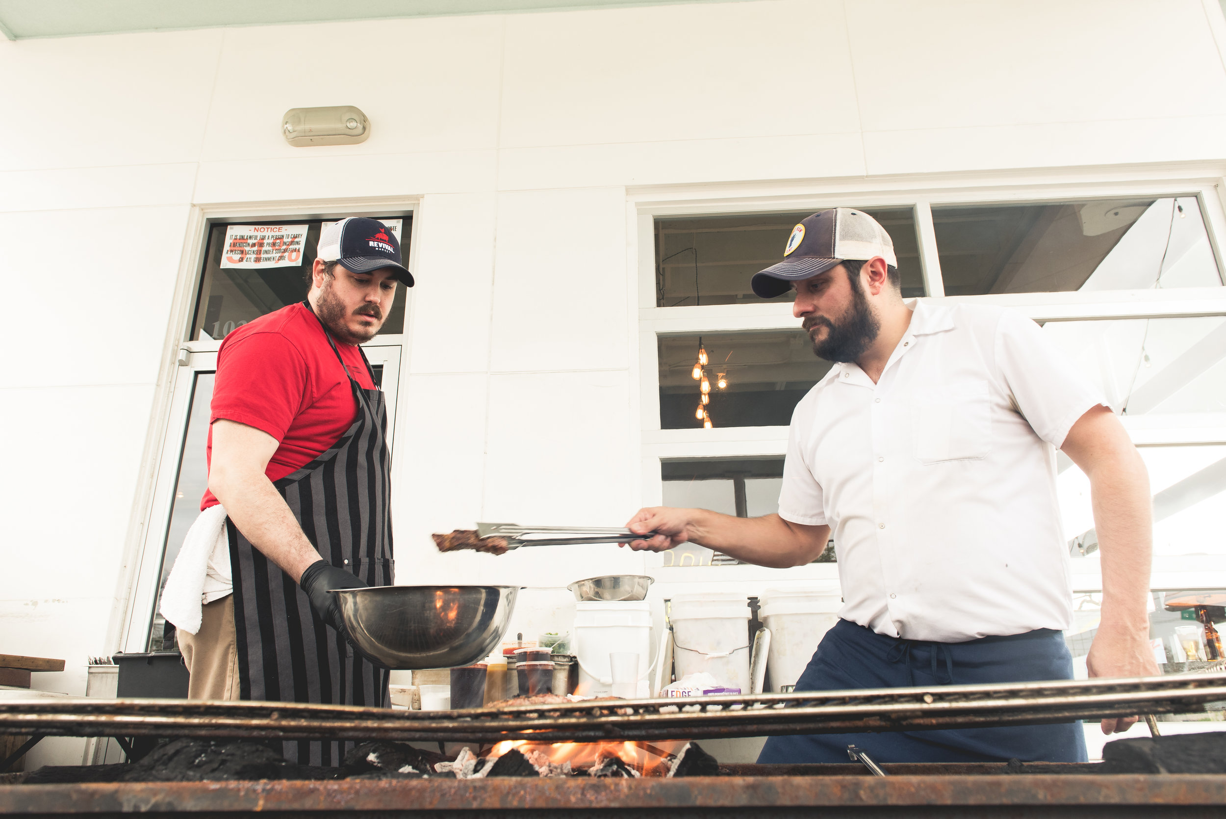 Revival Market's Todd Patterson and Marcelo grilling ribs
