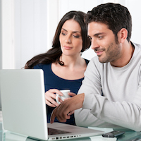 depositphotos_31199599-stock-photo-smiling-couple-with-laptop.jpg