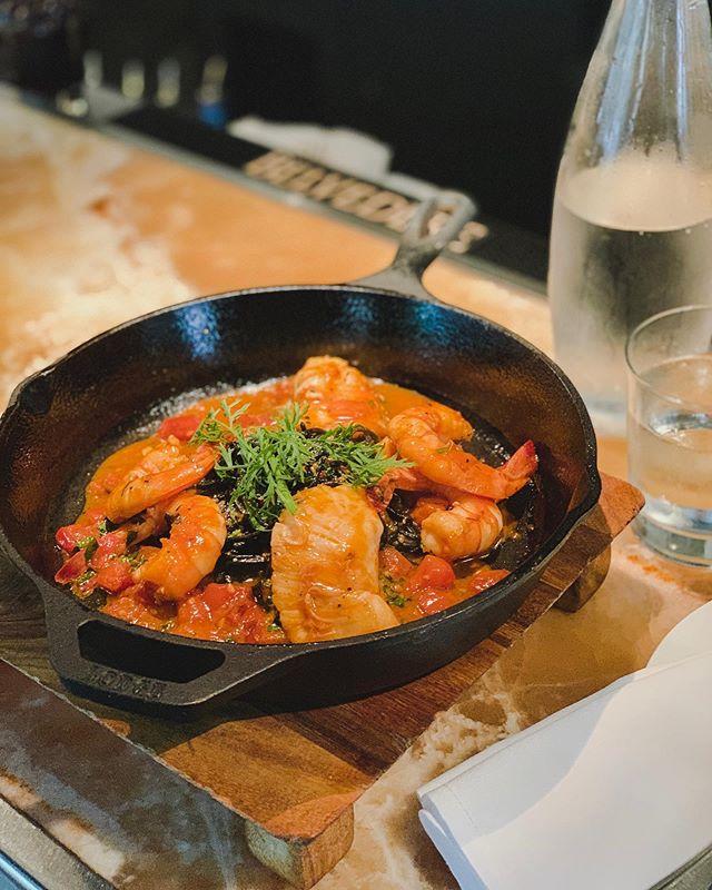 Chef's seafood special: prawns, halibut cheeks over squid ink spaghetti and tomato sugo. #baroloristorante #baroloseattle