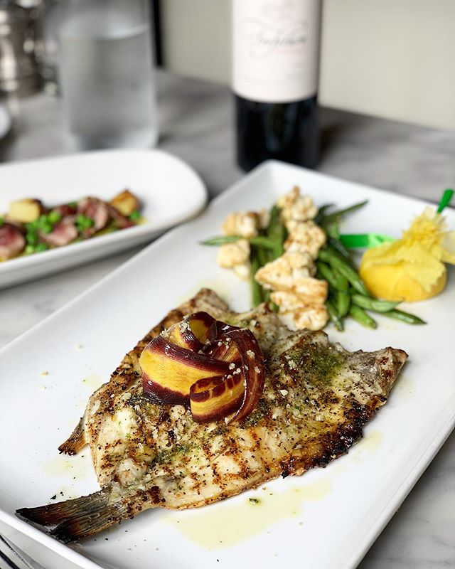 Mediterranean butterfly cut Branzino with herb remoulade, French green beans and roasted organic cauliflower. #chefspecial #baroloseattle