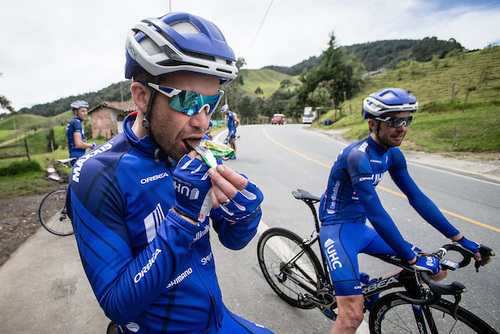 A UnitedHealthcare Pro Cycling athlete refuels with a Honey Stinger Protein Bar. Photo by Jonathan Devich.