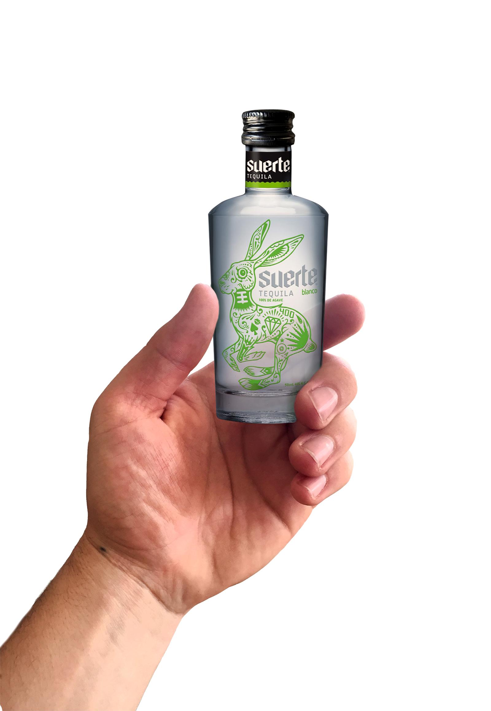 50 Ml bottle in hand flat.jpg