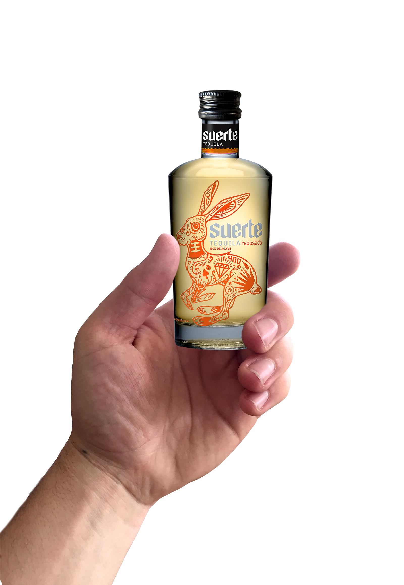 50 Ml bottle in hand Repo flat (1).jpg