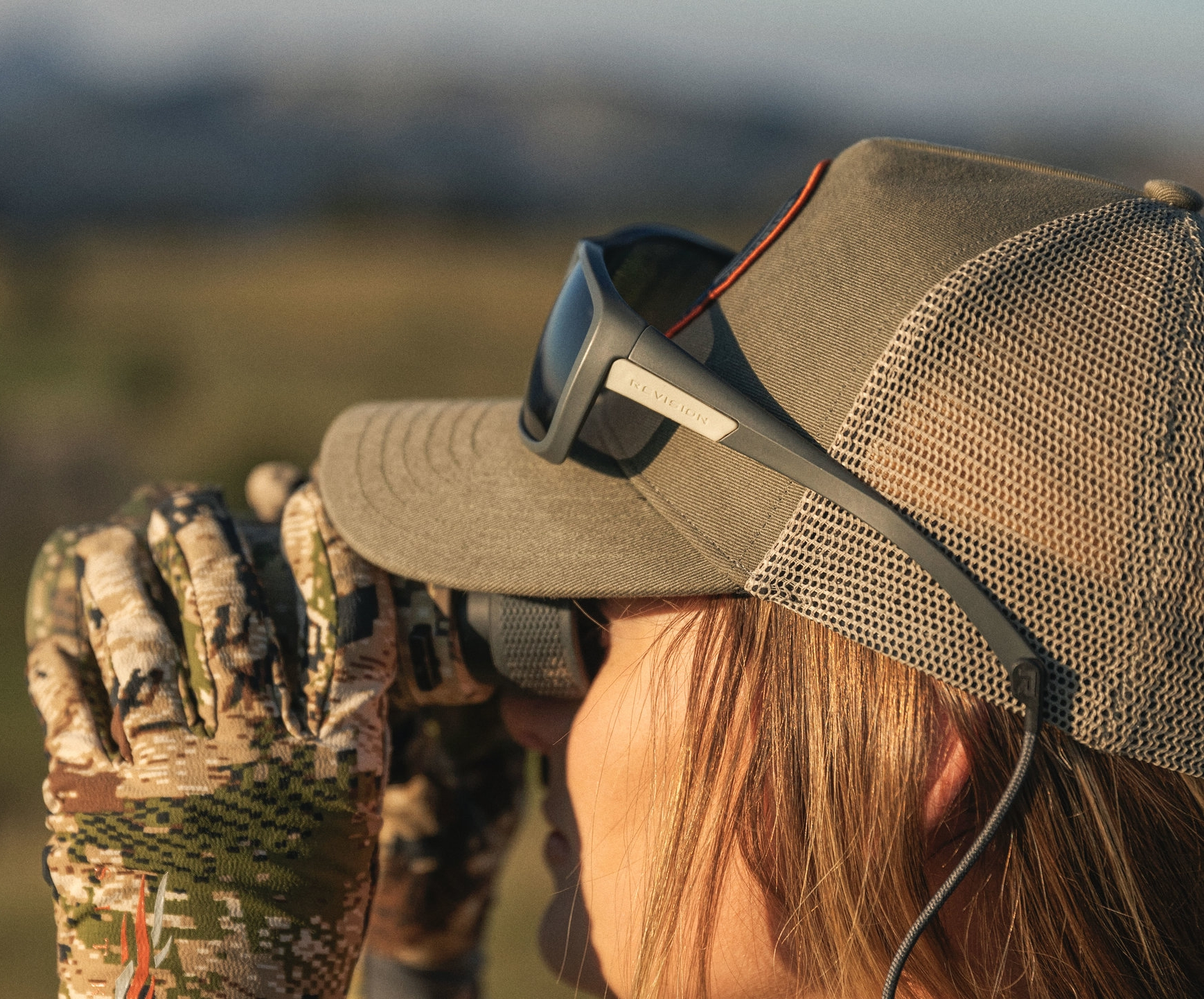 The Revision Pursuer™ shown in rocky scree frame and slate lens tint with the integrated retention strap.