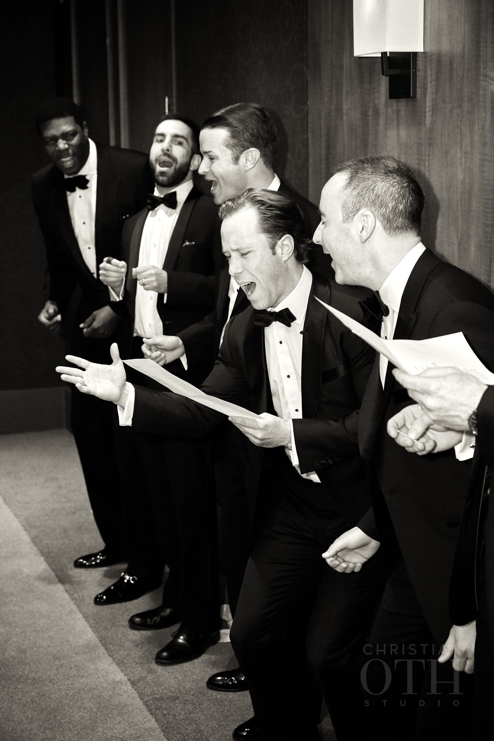 The groomsmen sang as part of the door games.  Photo by Glen Allsop for Christian Oth Studio.