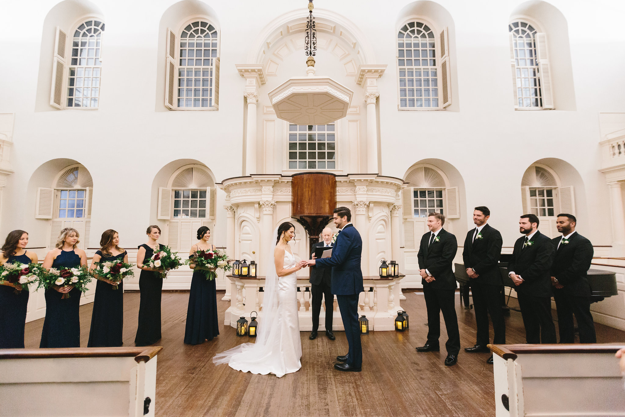 Sarah and Justin exchange vows at the Old South Meeting House for their Boston Wedding.  Photo by  Lindsay Hite Photography .