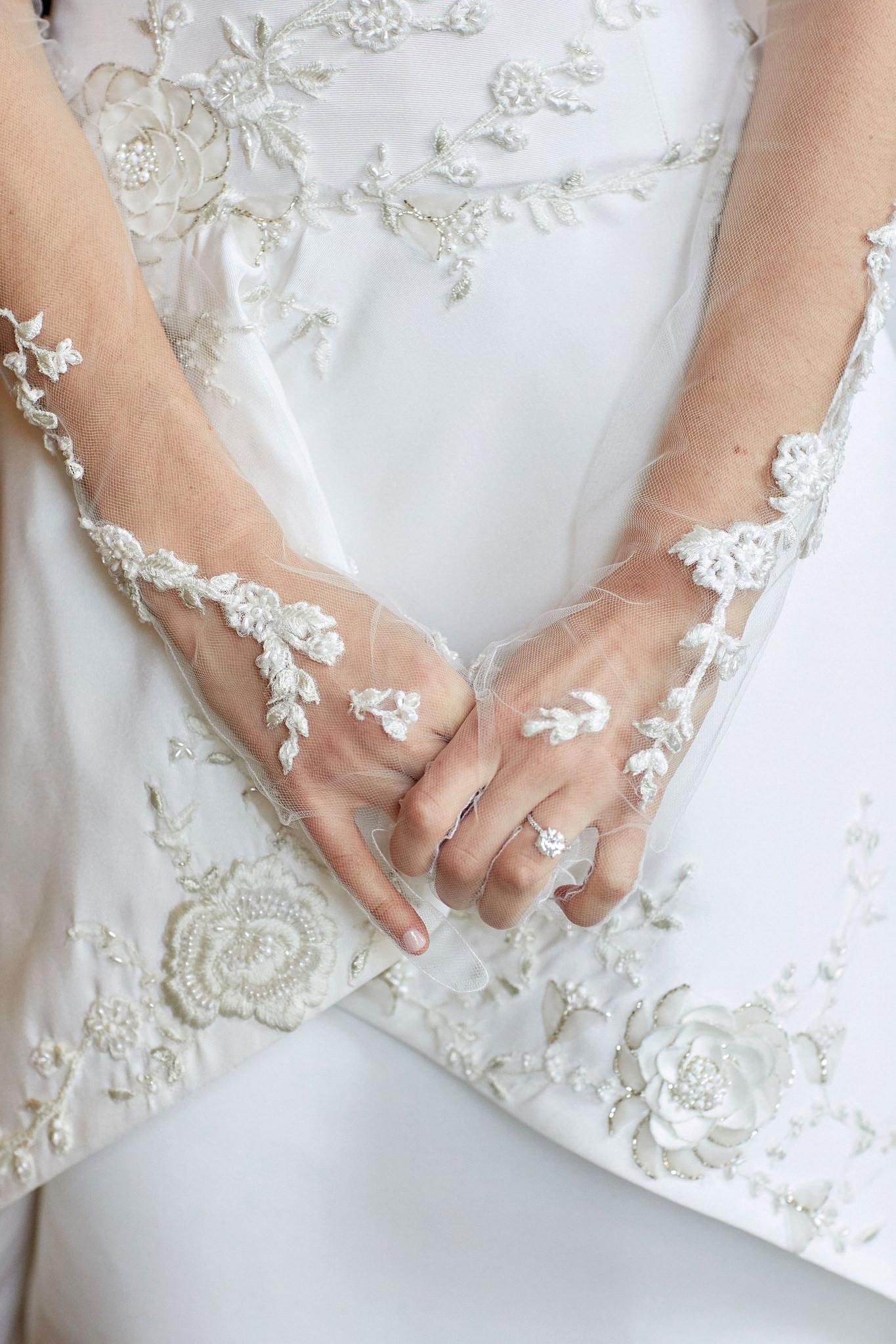 Detail on bride's custom gloves