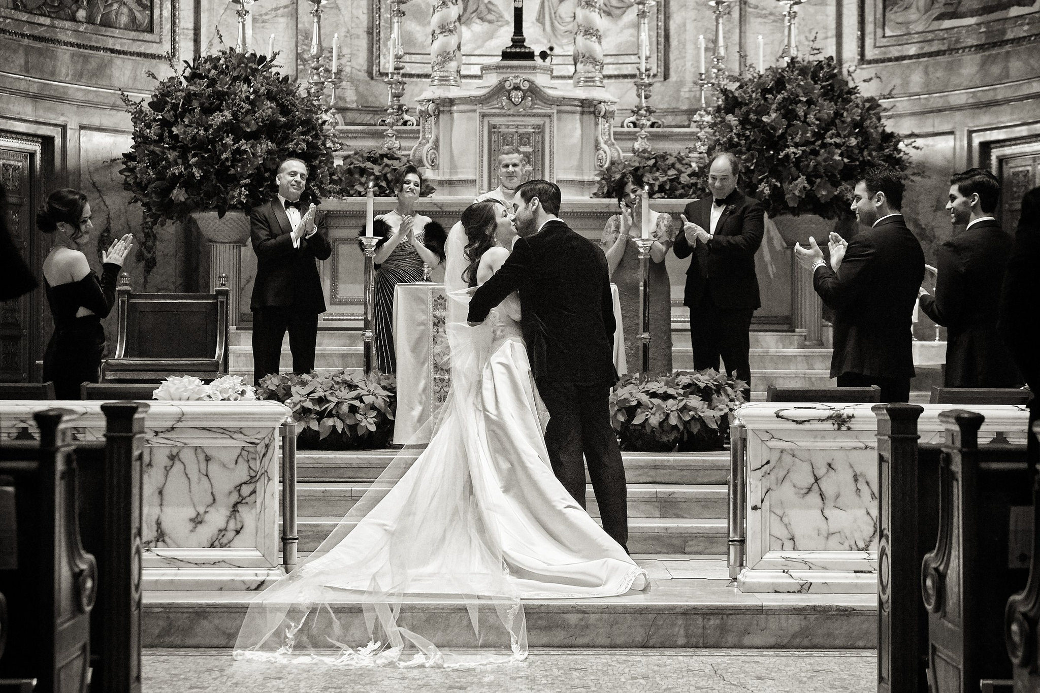 First kiss as husband and wife at St. Ignatius Loyola