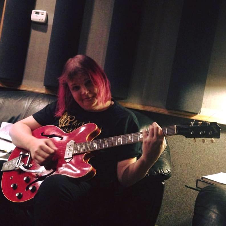 Cait Brennan with Chris Bell's guitar