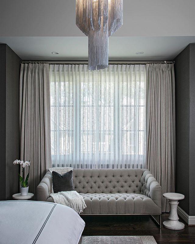 Taking Labor Day weekend very seriously.  Rest + Restore #katierodriguezdesign #interiordesign #interiordesigner #chandelier #bedroomdecor #tuftedsofa #marbletable #drapery #bedding