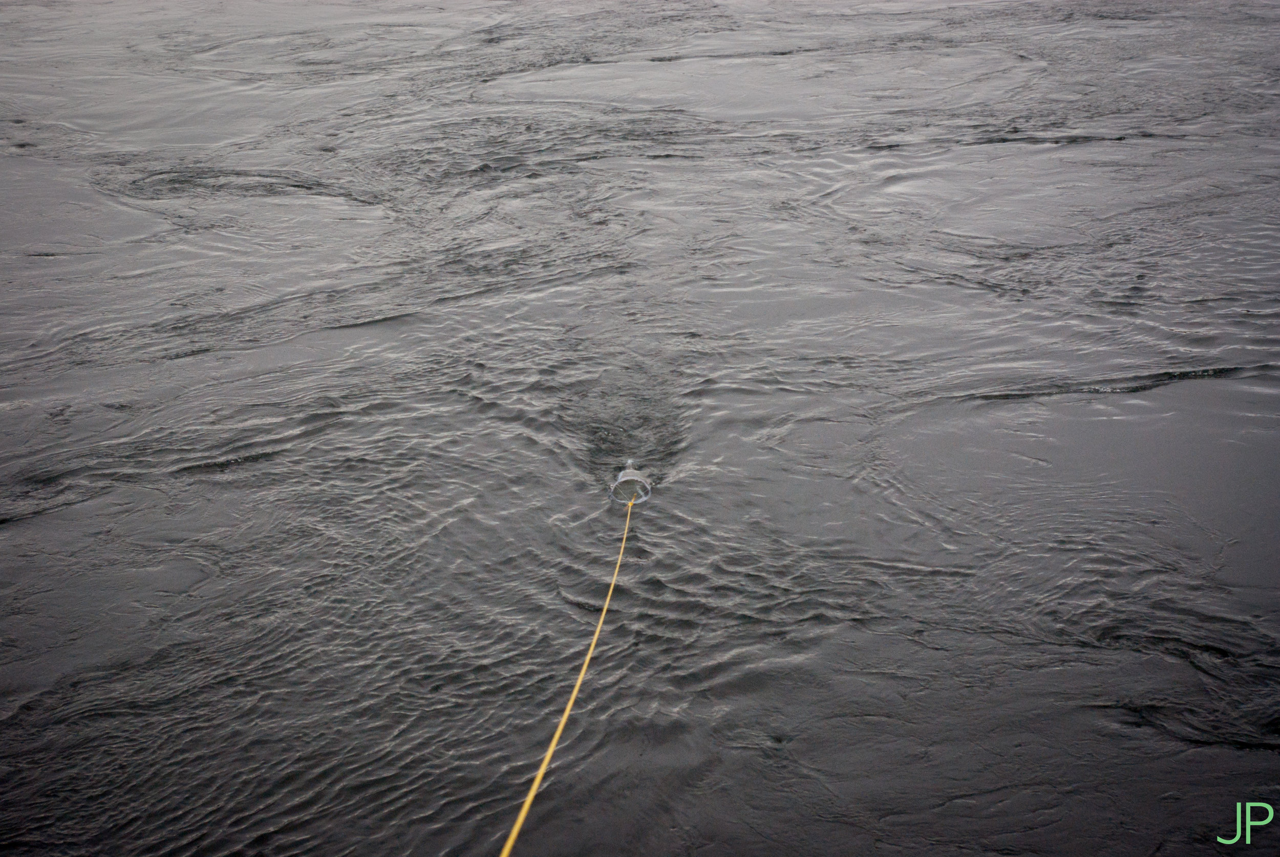 Sampling for microplastics involves towing a net in the river to filter capture the microplastics.