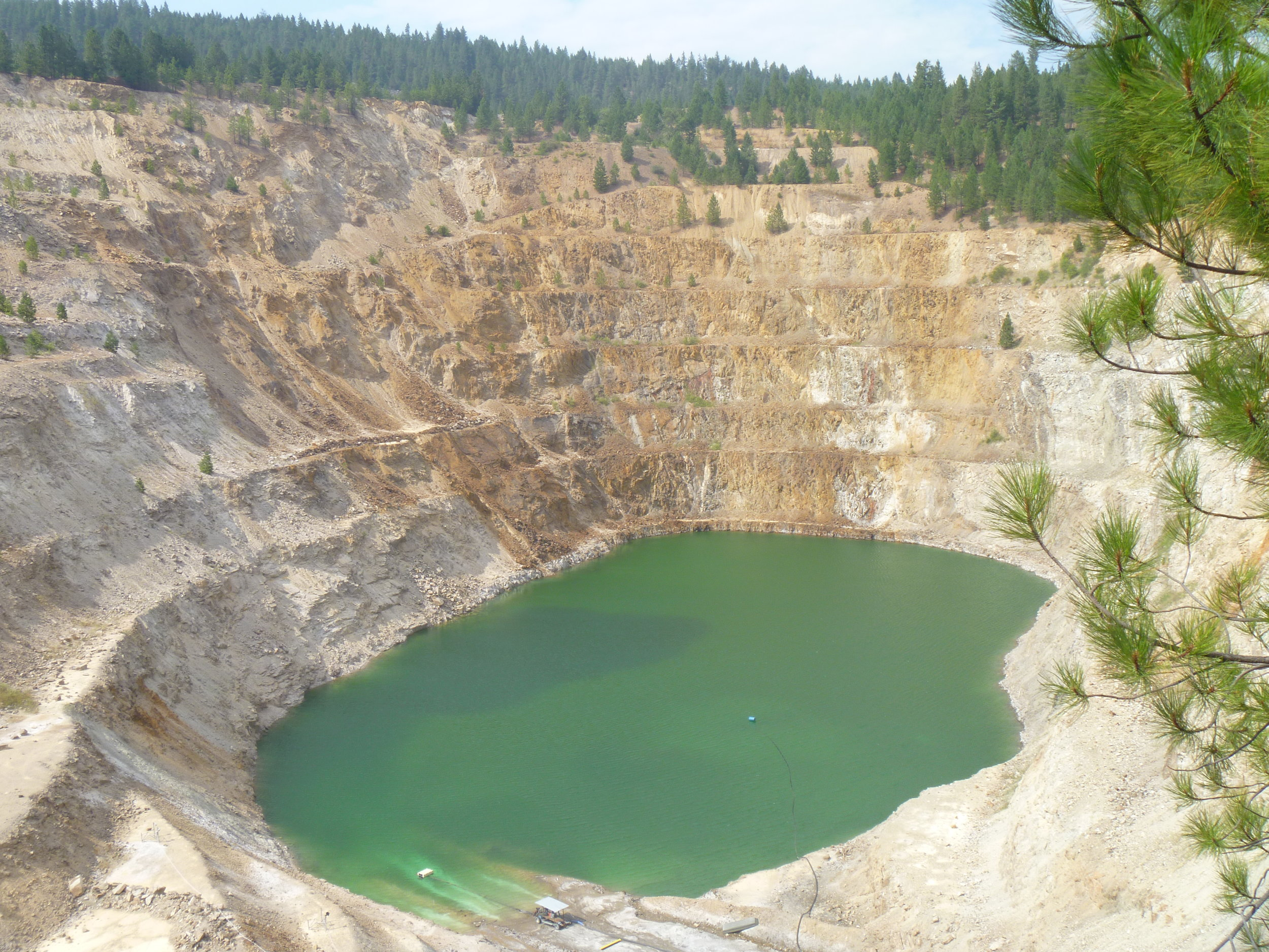 The Midnite Mine (pictured) is a superfund site on the Spokane Indian Reservation consisting of an open bit uranium mine that pollutes nearby waters with Radium-226.