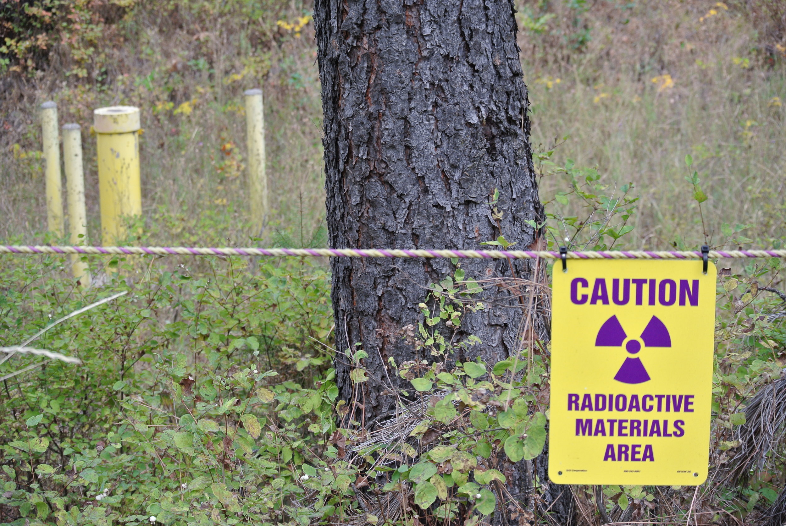 The Midnite Mine is designated a Superfudnd site because mining contaminants Radium-226, Lead 210, and Uranium are found in concentrations that would cause cancer in greater than 1 in 10,000 people.