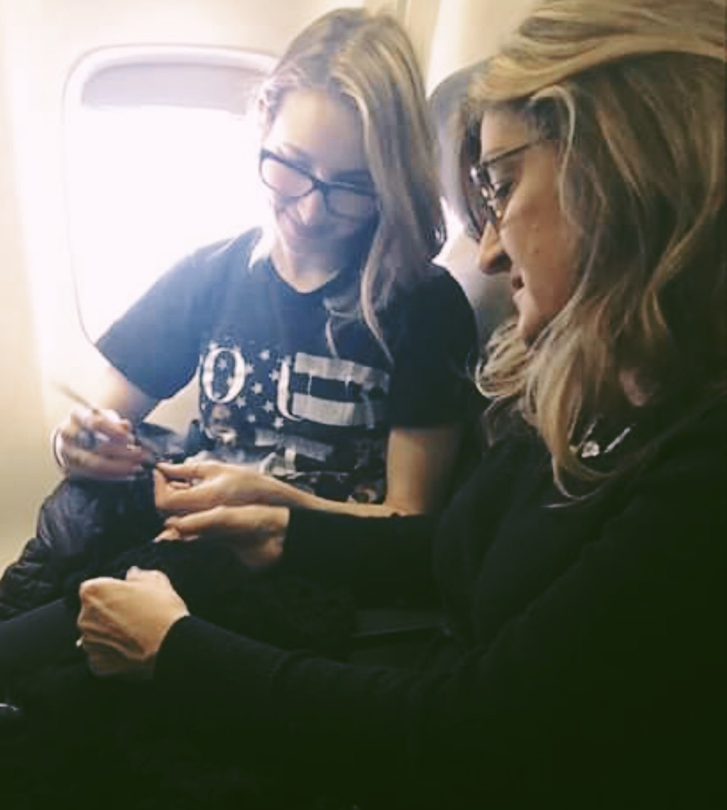 Sitting next to my mom on the plane while finishing my dress