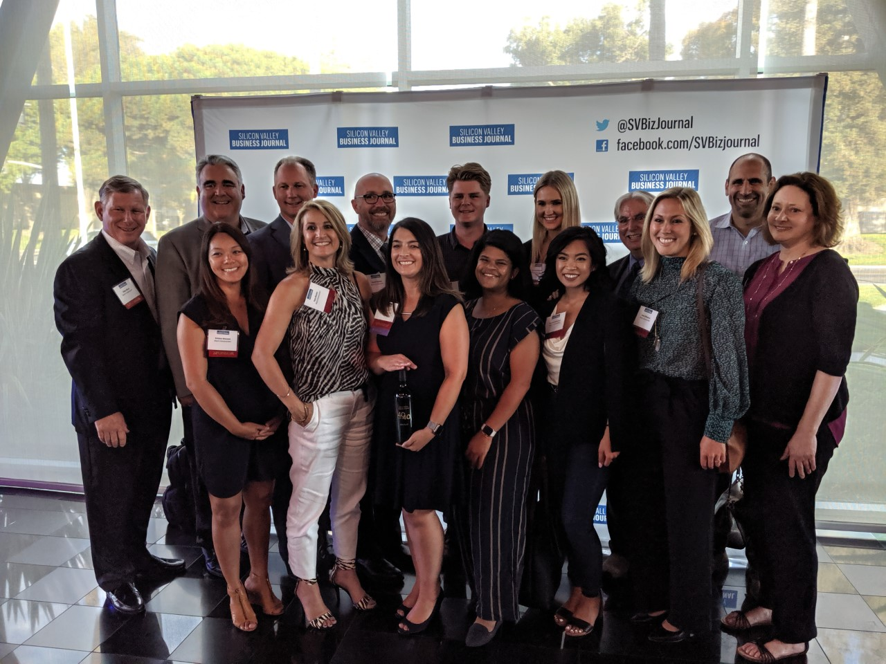 A group shot of Blach Construction employees celebrating Kim at the event.