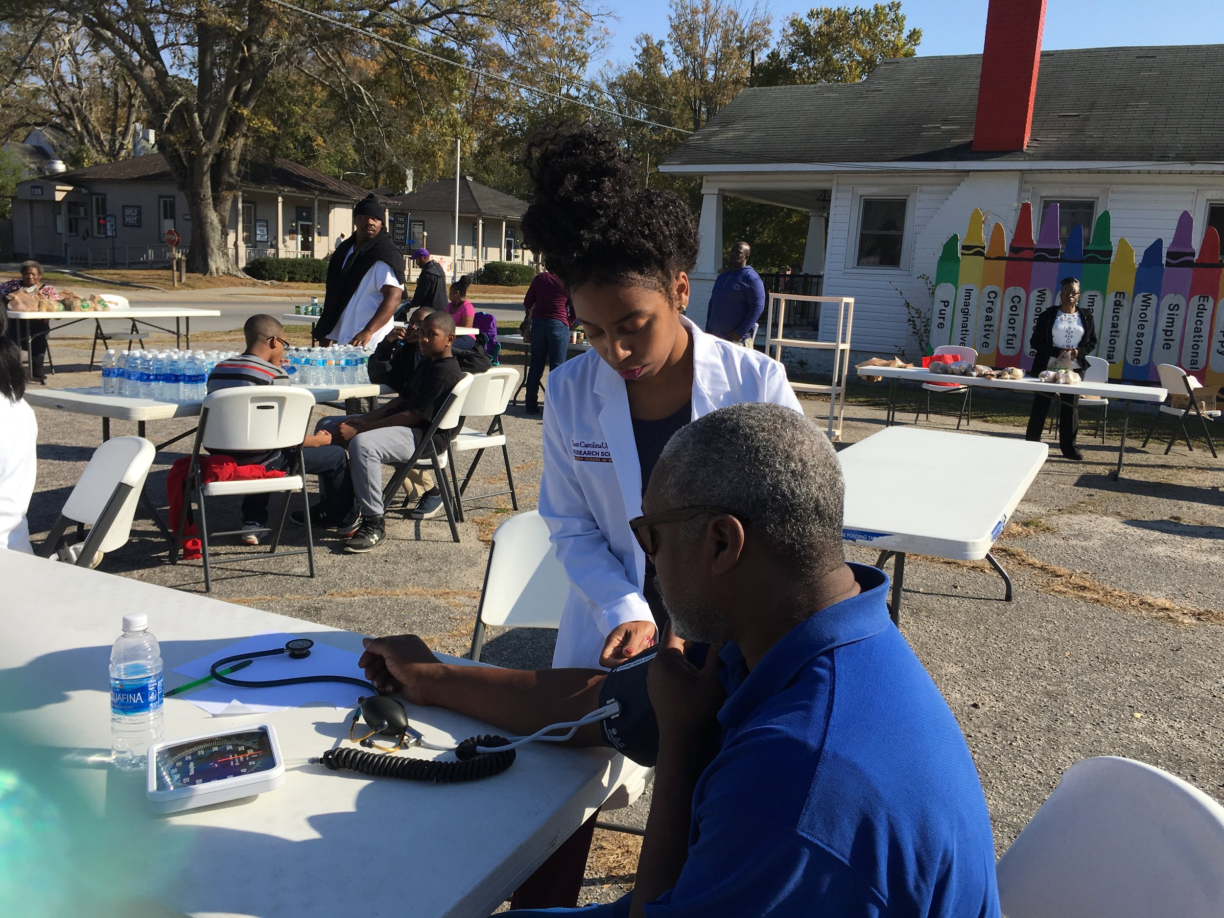 Briana's non-profit UmojaLife hosted a community event in Greenville, North Carolina. The event included medical screening, health education, and a meal give-away.
