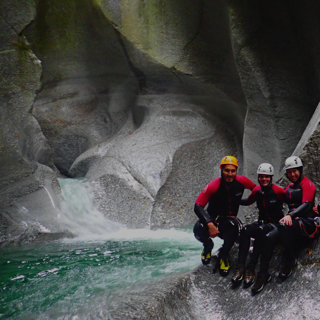 Canyoning Switzerland - Hiking, swimming, jumping, sliding, and rappelling through natural and wild canyons in the Swiss Alps