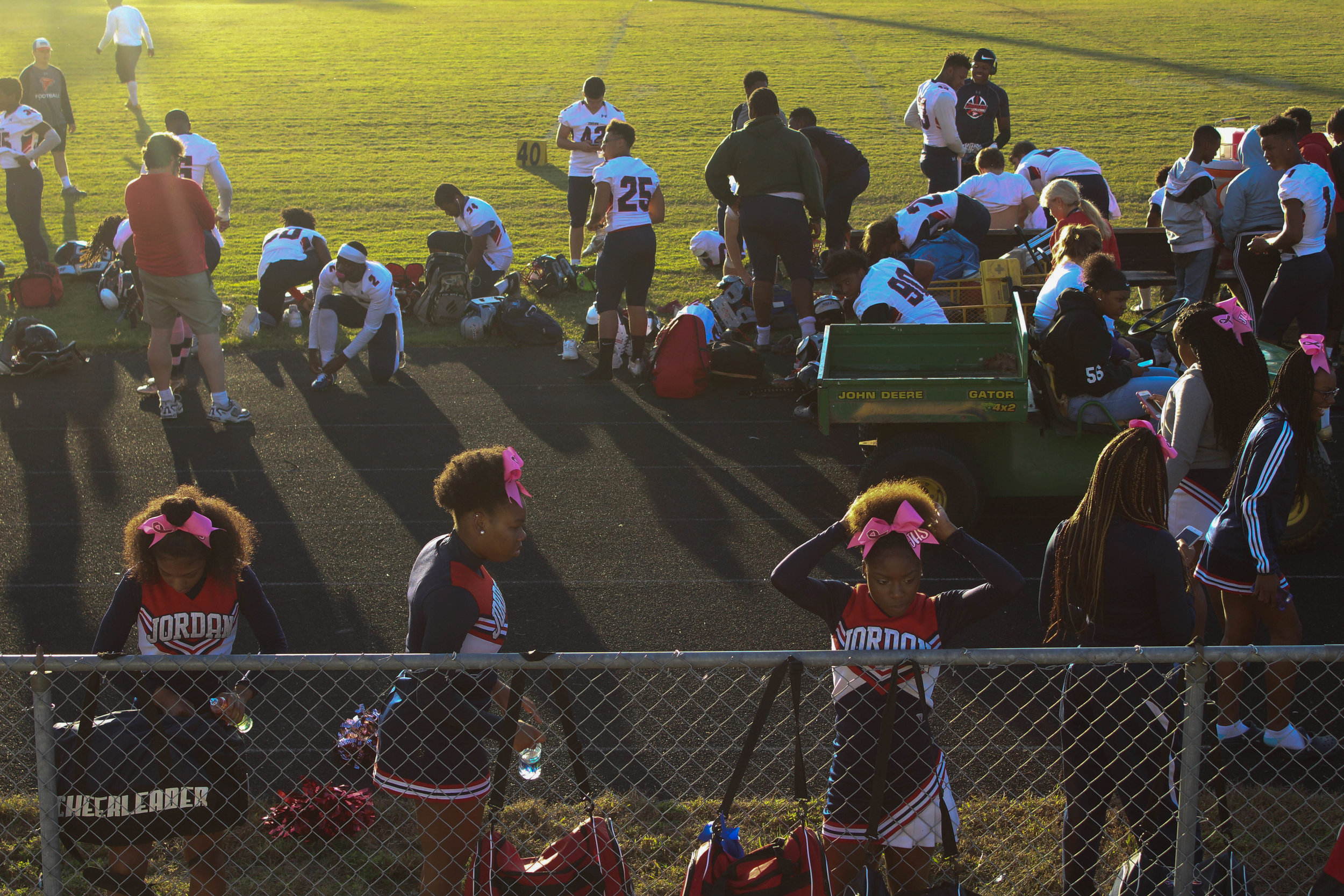 Jordan's cheerleading and football teams prepare for their last away game at Riverside High School. They arrive one hour early so that the boys have plenty of time to dress for the game and the girls can practice their cheers.