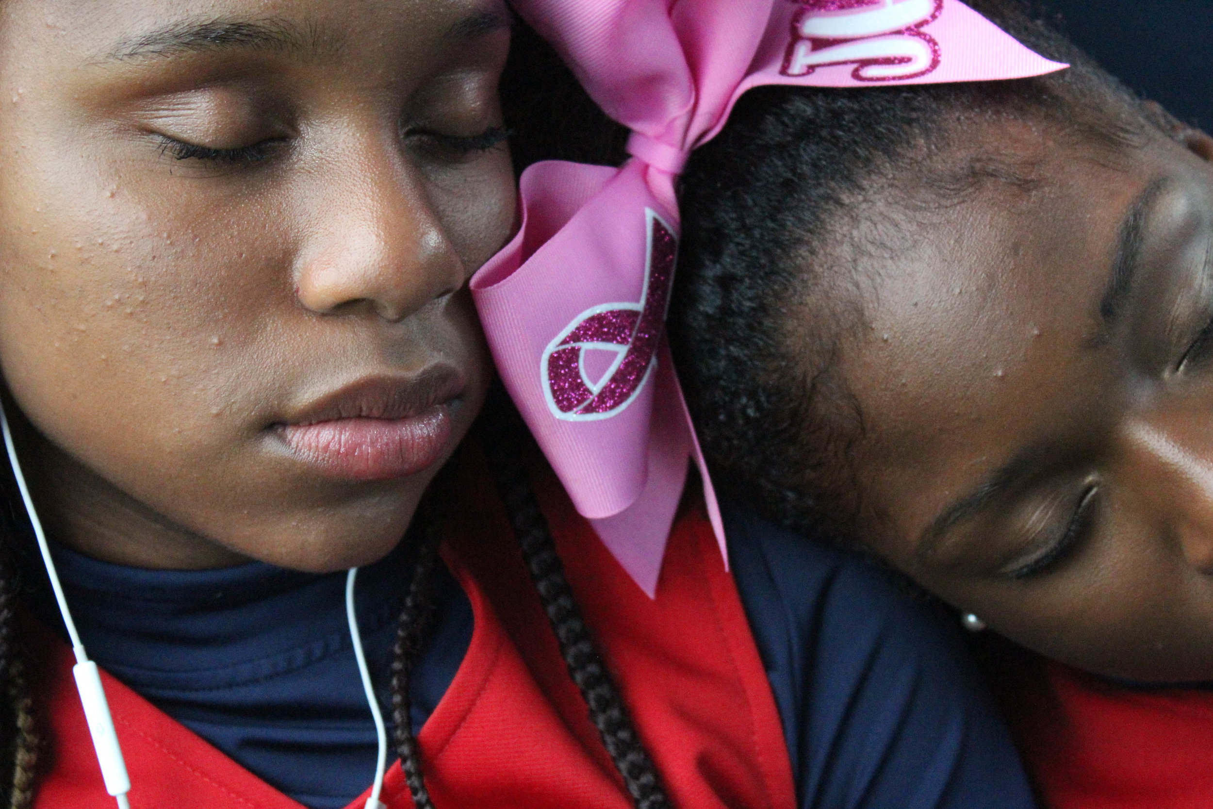 "The two team captains, Alanna Autry (left) and Senam Batse (right), take a nap on the bus to Riverside High School. ""Our bond is what makes our team special,"" says Alanna."