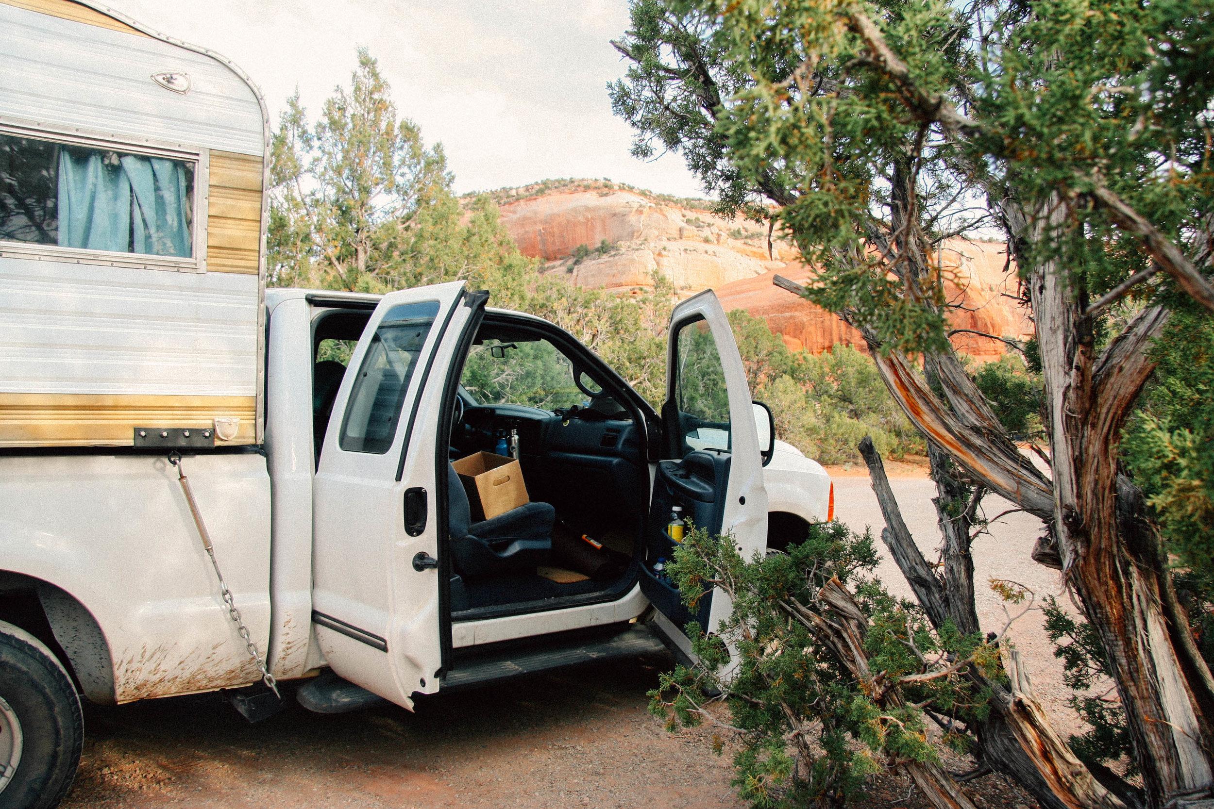 The camper truck/home camped by Utah Juniper,  Juniperus osteosperma ( Cupressaceae) and Two-needled Pinon Pine,  Pinus edulis  (Pinaceae) near Canyonlands National Part, Utah.