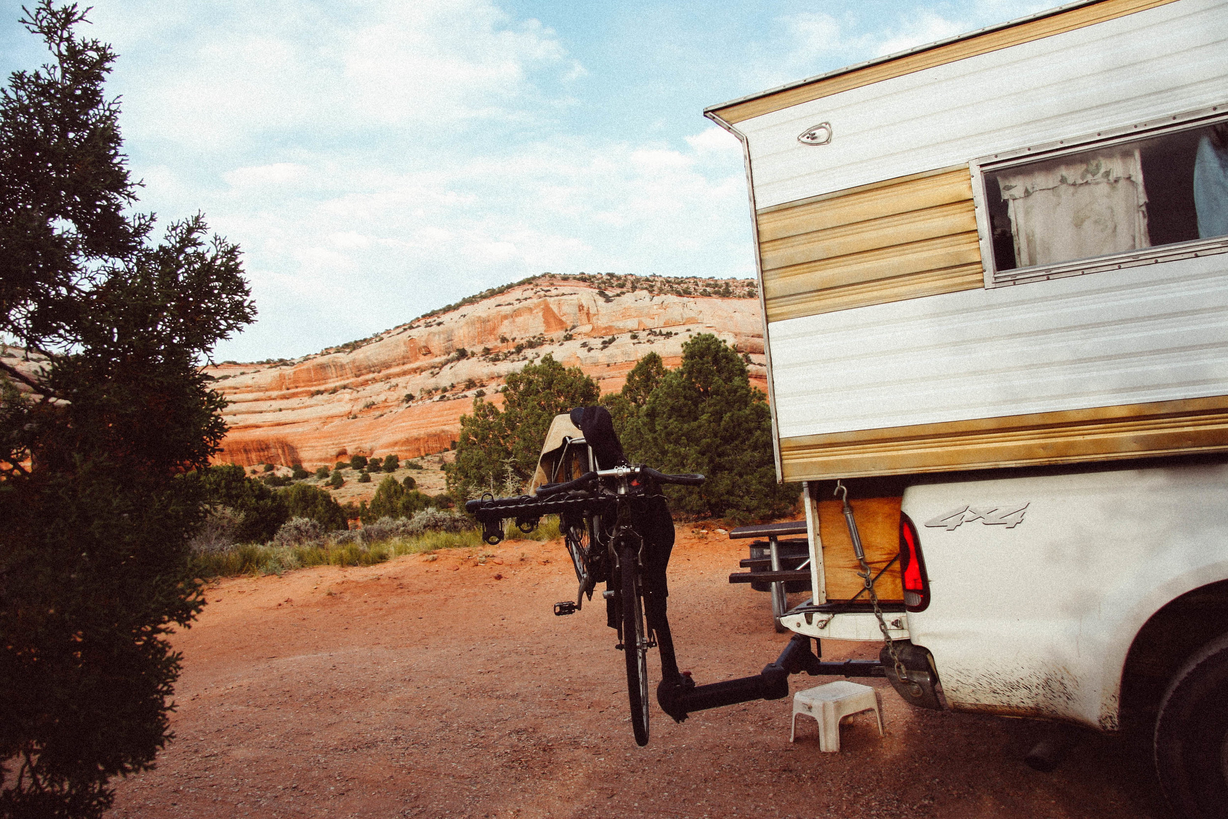 The camper truck/home camped by Utah Juniper,  Juniperus osteosperma ( Cupressaceae) and Two-needled Pinon Pine,  Pinus edulis  (Pinaceae) near Canyonlands National Part, Utah.  The bike rack makes for a good place to hang drying clothes.