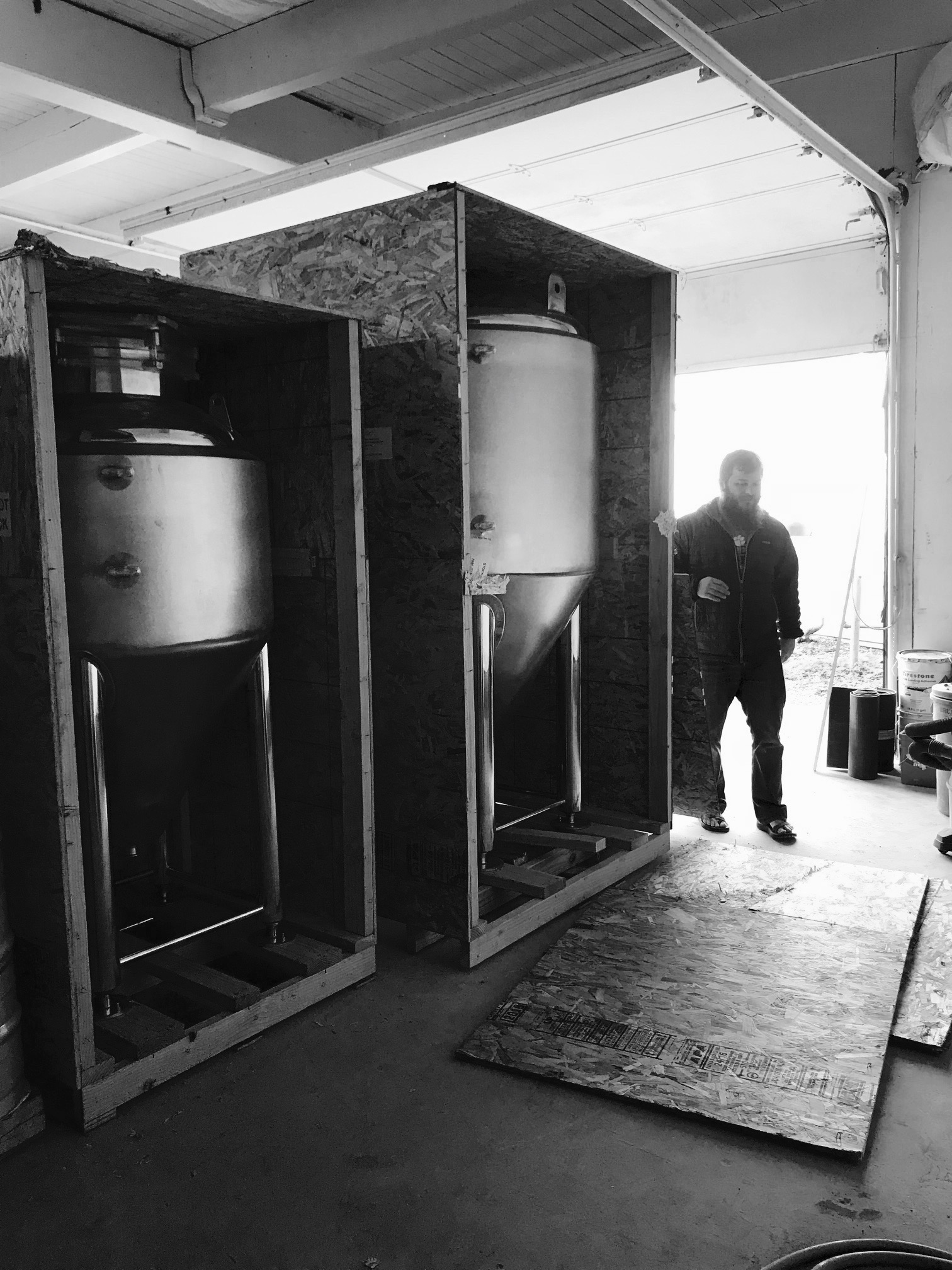 Unboxing the new fermenters at the Shattuck Way brewhouse entrance.