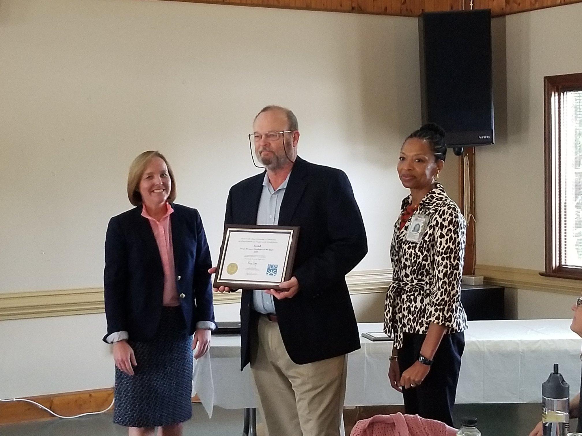 John Roberts; President & CEO accepts the award on behalf of Nextek, Inc