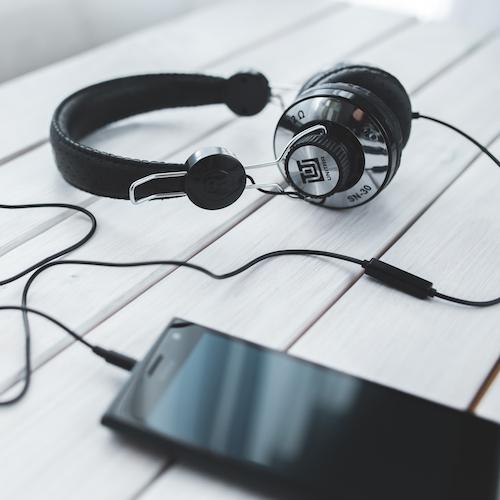 Canva - Black vintage headphones with mobile smartphone.jpg
