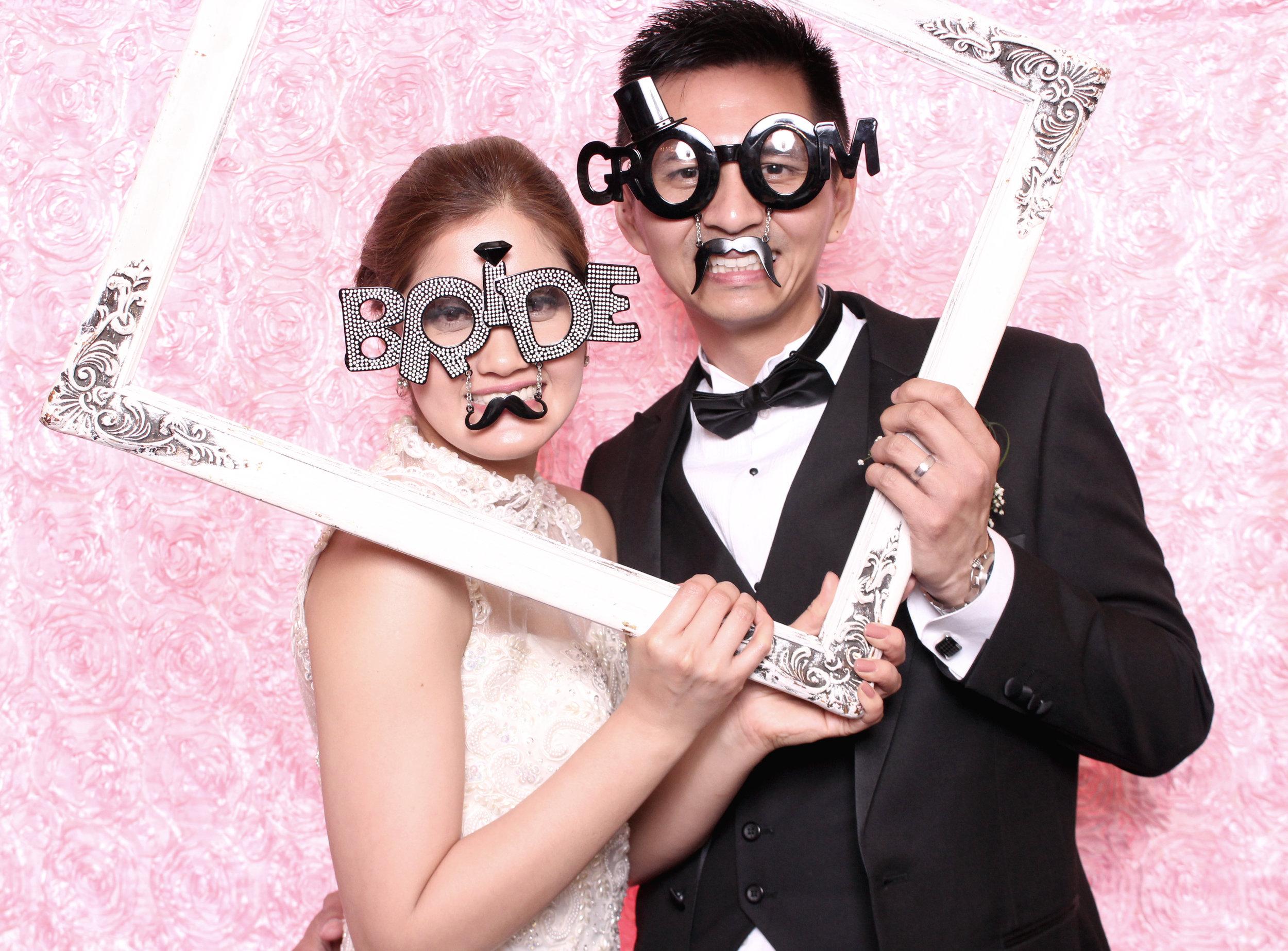 bride and groom pink backdrop.jpg