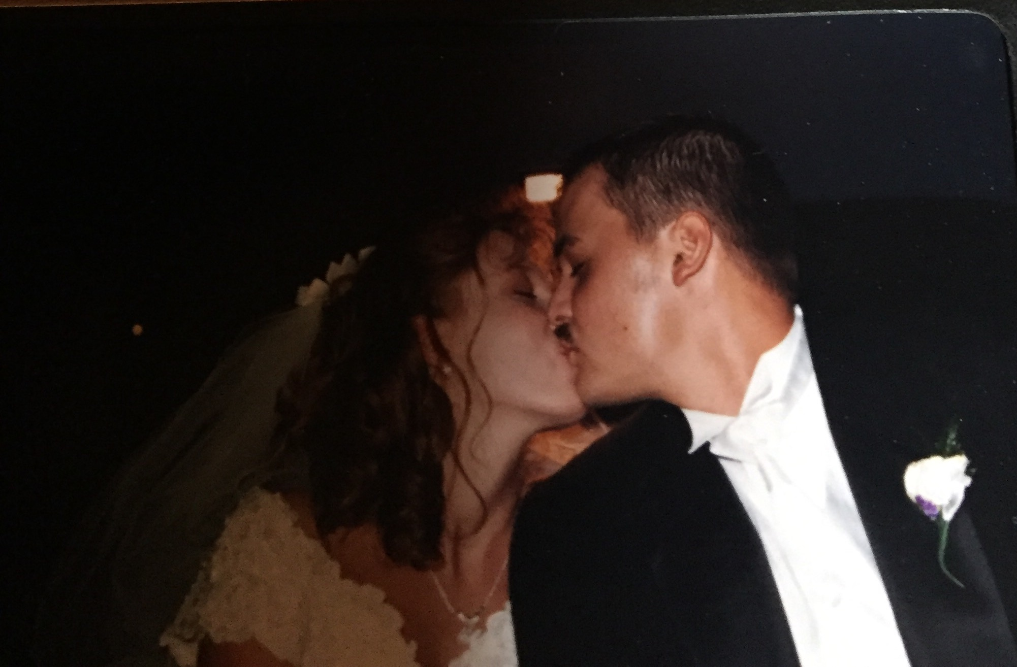 Our first kiss after the kiss at the alter.  We were headed to the reception.  Praise Jesus we are still kissing today!