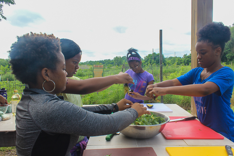Little Sisters Making Kale Salad w/ Raspberry Vinaigrette Our Mothers' Kitchens 2017 Summer Workshop for Girls  Photo by Gabrielle Clark