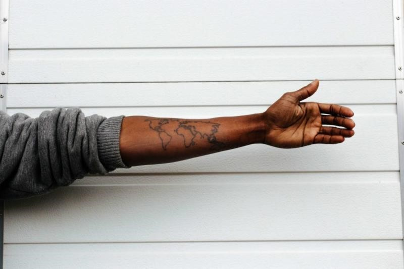 wold map arm tatto.jpg