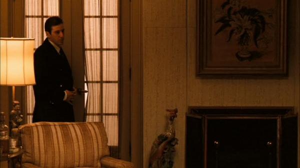 Vito Corleone (Robert De Niro) and Michael Corleone (Al Pacino).