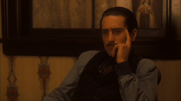 Signora Colombo makes her plea to Don Corleone, the Holy Mother behind him, a scene subtly reminiscent of his mother's supplication to Ciccio for Vito's life.