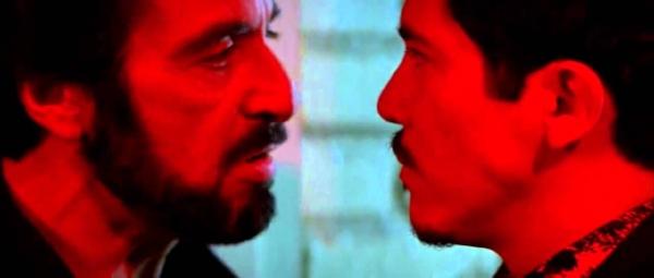 Carlito squares off against his double-of-sorts, Benny Blanco (John Leguizamo)