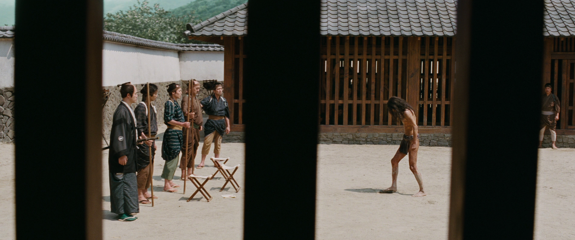 A  fumie-e  formality, Scorsese's framing evoking modern day cell-phone videos which stress the vertical composition.