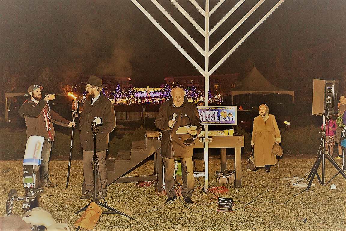 Cantor Kutner singing the Hanukkah Blessing