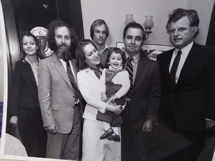 The author, held by her mother, father to the left, Senator Ted Kennedy who sponsored their emigration and members of his staff. 1981.